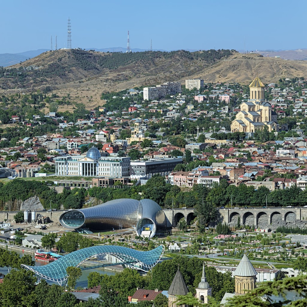 View of the Holy Trinity Cathedral, Building of Presidential Administration, Concert hall and pedestrian Bridge of Peace