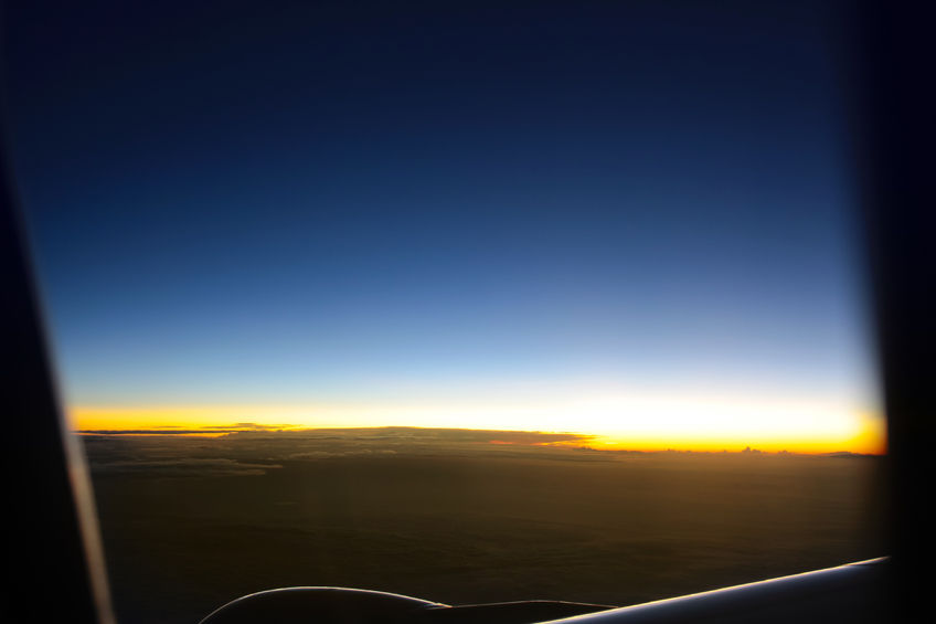 43348078 - airplanes window seat view with sunsetsunrise