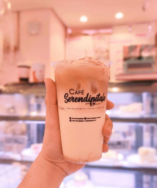 Cafe Serendipitale Hand Holding Cup of Iced Coffee