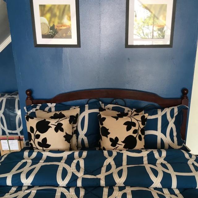 Nova Scotia Beach Resort bed with comforter and linen